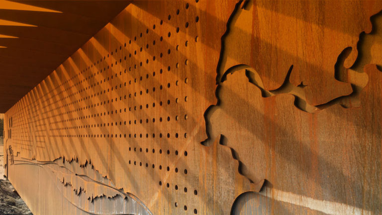 LEDs above Boreal forest symbol, Interactive Steel Wall